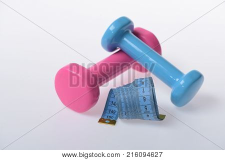 Barbells Next To Cyan Measure Tape, Close Up. Fitness Symbols