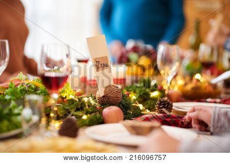 Menu at Christmas dinner table at restaurant