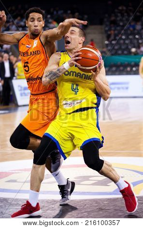 CLUJ-NAPOCA, ROMANIA - 26 November 2017:Anthony Williams (L) of Netherlands and Andrei Mandache of Romania in action during FIBA Basketball World Cup 2019 qualifier game between Romania and Netherland