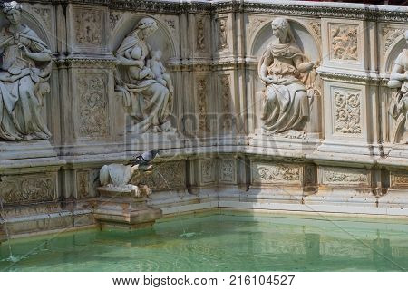 SIENA, ITALY - MAY 25, 2017: Fonte Gaia (fountain of joy), with the Virgin Mary and baby Jesus. Piazza del Campo (Campo square).