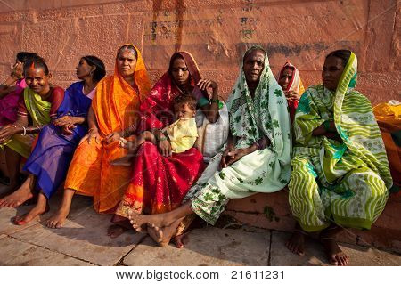 Women In Colorful Saris Sit And Watch Solar Eclipse