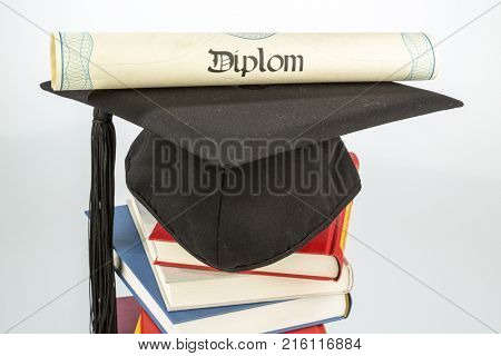 mortarboard on stack of books