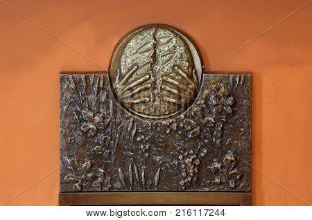ZAGREB, CROATIA - MARCH 31: The symbols of the Eucharist, bas relief in Chapel of Saint Dismas in Zagreb, Croatia on March 31, 2015