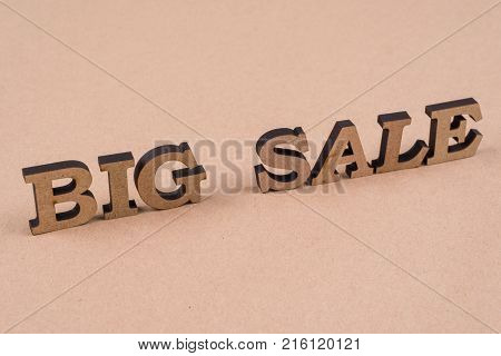 Word BIG SALE abstract wooden letters, background vintage kraft paper