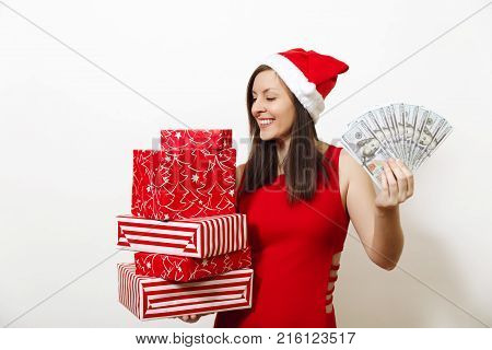 Pretty Caucasian Young Happy Woman In Red Dress And Christmas Hat Holding Gift Boxes And Money Bankn