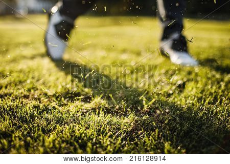 Golf player walking and carrying bag on course during summer game golfing