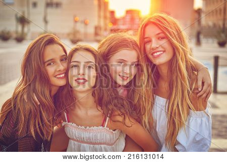 Best friends teen girls at sunset in the city filtered image
