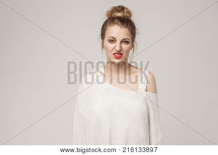 Blonde Woman Looking At Camera With Disgust