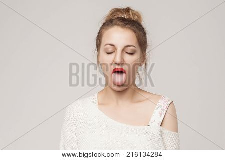 Funny Woman Closed Eyes And Tongue Out .