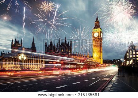 explosive fireworks display fills the sky around Big Ben. New Year's Eve celebration in the city