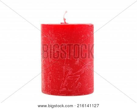 Red, bright, thick wax candle with a wick stands, isolated on white background, concept of holidays, new year, valentine's day