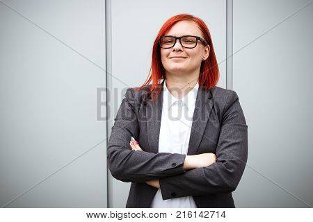 Business Concept Of Success. Serious Successful Woman Boss, In A Suit. With A Place For Advertising