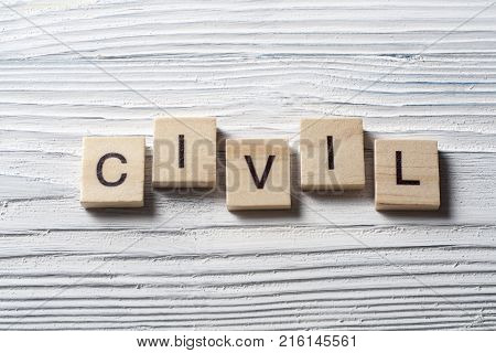 Word CIVIL written on wooden cubes.Wood abc.