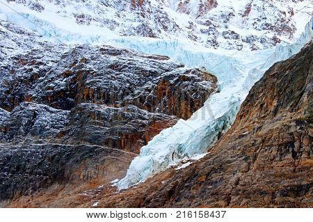 Angel Glacier hangs over a cliff below Mount Edith Cavell in Jasper National Park Canada