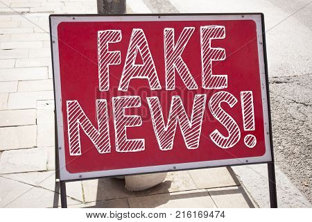 Writing Text Showing Fake News Made In The Office With Surroundings Such As Laptop, Marker, Pen. Bus
