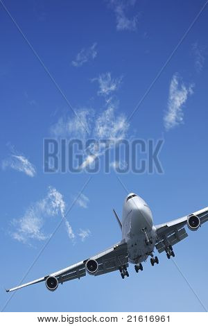 Jet aircraft is maneuvering in a blue sky poster