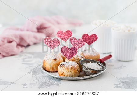 Valentine Sultana Cupcakes Dusted with Icing Sugar Decorated with Pink Glitter Hearts copy space for your text