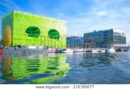 Lyon France - December 9 2016: Confluence district the Green Cube building on the Saone river bank