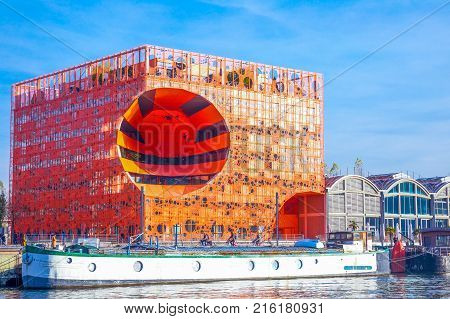 Lyon France - December 9 2016: Confluence district the Orange Cube building on the Saone river bank