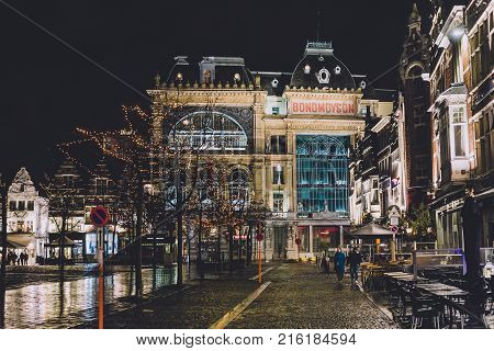 January, 2th, 2017 - Ghent, East Flanders, Belgium. Socialist guild Hall Bond Moyson and christmas illumination on Friday market in Gent during winter festival by night.