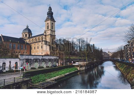 January, 3th, 2017 - Ghent, East Flanders, Belgium. Church of Our Lady and St. Peter and Benedictine abbey on river bank in Gent also known as Sint-Baafsabdij by sunny day.