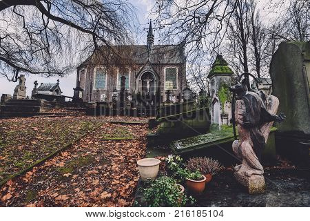 January, 4th, 2017 - Ghent, East Flanders, Belgium. Saint Amandus chapel on Campo Santo historical cemetery in Sint-amandsberg, Gent. Roman church, ancient tombs, graves and animal monument.