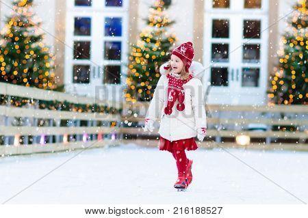 Kids Ice Skating In Winter. Ice Skates For Child.