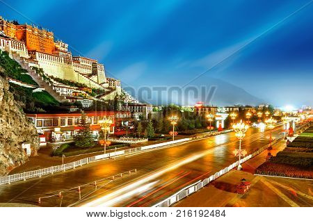 Potala Palace in Lhasa the former residence of the Dalai Lama Tibet China Asia night horizontal city view.