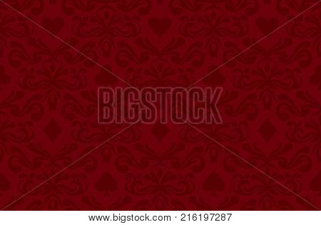 Seamless background with poker symbols surrounded by floral ornament pattern
