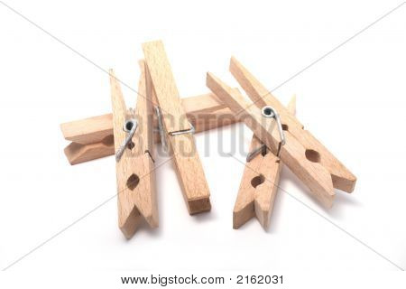 Clothes Pins On A White Background