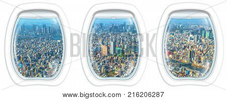 Three porthole frame windows on Tokyo skyline on background from Tokyo Skytree observatory. View from the highest tower in Tokyo. Sumida District, Japan.