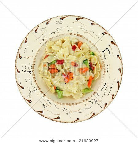 A single serving of pasta Primavera in a southwestern style bowl on a white background. poster
