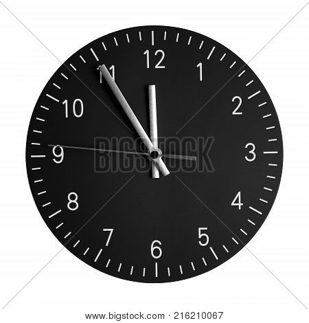 isolated wall clock with its hands at 5 to 12. concept for high time or 5 minutes to midnight.