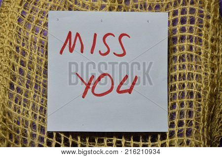 word miss you on an abstract colored background