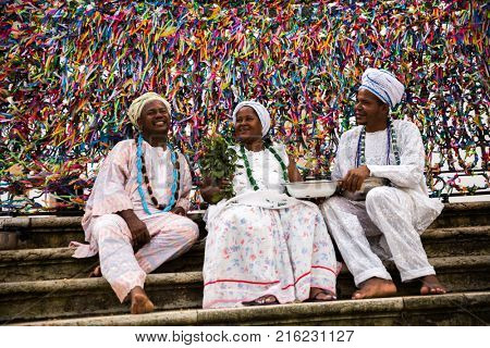 Candomble group wearing traditional clothes at Bonfim Church in Salvador, Bahia, Brazil
