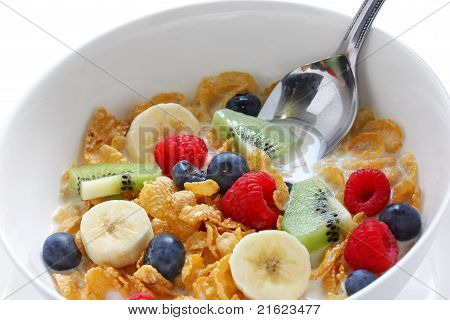 breakfast cereal with fresh fruits(strawberries,kiwi fruit and banana) pouring milk