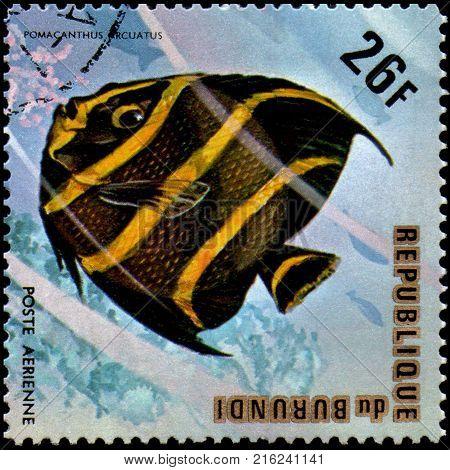 BURUNDI - CIRCA 1974: a postage stamp, printed in Burundi, shows a fish Gray Angelfish (Pomacanthus arcuatus)