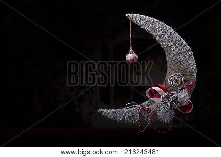 Christmas card. Christmas background with a month Christmas tree toy with a cone on a black background
