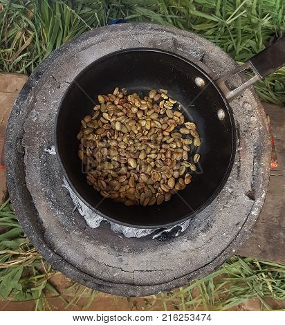 Traditional roasting of coffee beans in a pot in Ethiopia