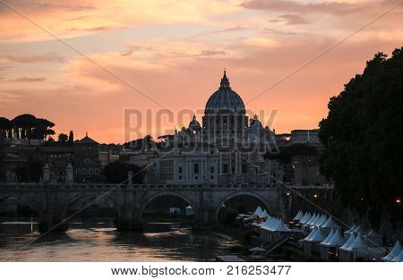 View of St. Peter's Basilica and the Tiber River at sunset Rome Italy