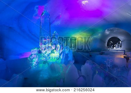 DACHSTEIN MOUNTAINS, AUSTRIA - JULY 17, 2017: Exposition of colorful ice sculptures at top of Dachstein Mountain in Austria