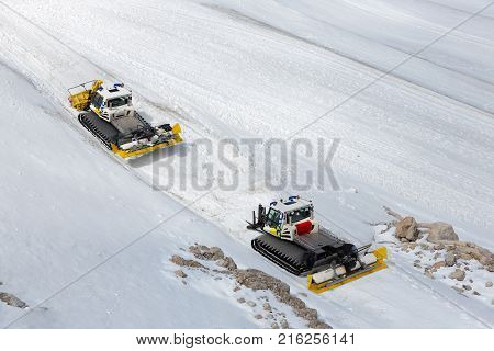 DACHSTEIN MOUNTAINS, AUSTRIA - JULY 17, 2017: Dachstein Mountain in Austria with with snowcat machines preparing the ski piste