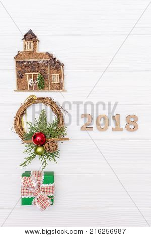 Above christmas and new year numbers 2018 with New Year ornaments and gift boxes on white background. Christmas and new year concept