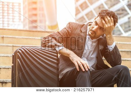 Unemployed businessman stress sitting on stair concept of business failure and unemployment problem work life balance image processing instagram vintage color.