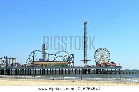 GALVESTON, TEXAS - NOVEMBER 26, 2017: Galveston Island historic Pleasure Pier on the Gulf of Mexico coast in Texas.