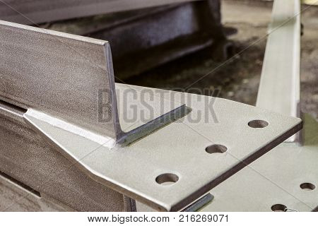Jointing shaped element of galvanized metal construction close-up. Limited depth of field.