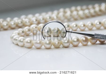 dazzling pearls and are reflected in a dental mirror