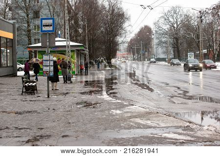 Latvia, Riga - December 1.2017: Wet snow in the city, traffic and people on the slippery streets.