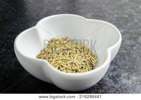 The Herb Rosemary Rosmarinus officinalis in a White Bowl