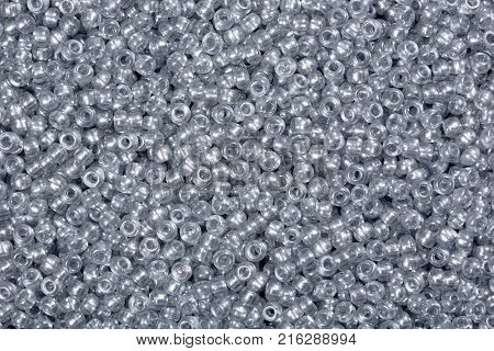Closeup photograph of multicolored Glass seed beads background. High resolution photo.